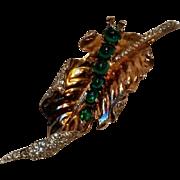 Trifari sterling vermeil caterpillar on a leaf fur clip  rhinestone green glass cabochon