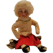 SOLD Antique Heubach Germany cotton bisque face girl on a log Christmas ornament