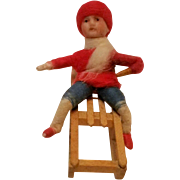 SOLD Heubach Germany Christmas ornament spun cotton bisque face boy or girl on sled