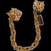 Trifari sweater clips simulated pearl rhinestone