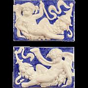 Pair of Angel, Cherub or Putti Plaques, Glazed Terra Cotta after Della Robbia