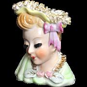 Earlier Lady Head Vase with Ceramic Ruffled Trim