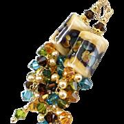 SOLD Gold and Brown Raku Long Lampwork Earrings