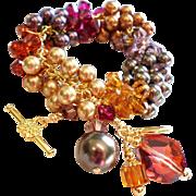 SOLD Swarovski Crystal and Swarovski Faux Pearl Cluster Charm Bracelet In Shades of Topaz, Ber