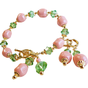 Pink Coral Colored Swarovski Faux Crystal Pearl Bracelet and Earrings Set With Peridot Swarovs
