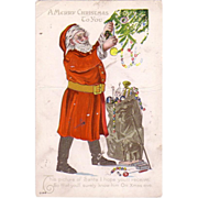 Christmas Postcard w/  Santa Claus decorating a Christmas Tree