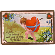 """Valentine Postcard """" Nude Cupid Carrying Heart on his Back """""""