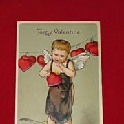 German Embossed Valentines Day Postcard Cupid as a Blacksmith