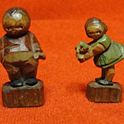 Pair of Miniature Carved Wooden and Stained Figurines
