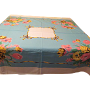 Yellow and Pink Flowers Against Blue Tablecloth - b173