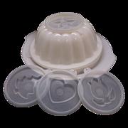 Tupperware Jel-N-Serve Seven Piece Mold Flower Star Tree Heart