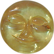 "Art Deco : Carved Applejuice Prystal Bakelite "" Man in the Moon "" Brooch"