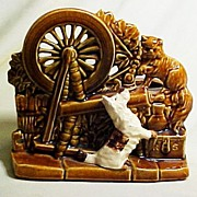 McCoy Spinning Wheel Planter with Applied Dog, circa 1953
