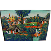 Colorful naive Central American or Brazilian painting of hillside village