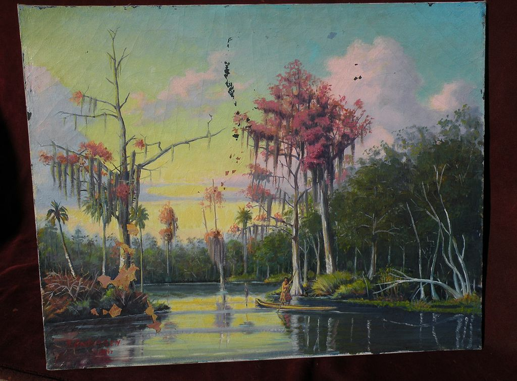 Florida art painting of Seminole indian paddling in swamp signed and dated