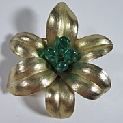 Trifari Goldtone Flower Brooch with Green Glass