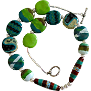 """Reduced Original Kazuri and Silver filigree beads necklace.  19"""" greens, navy and brown"""