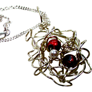 REDUCED Artisan necklace, Silver wire in a nest cloud.  Two red glass beads and a pearl silver