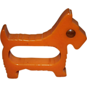 REDUCED Bakelite Orange Scotty Dog Bakelite Napkin Ring with Yellow Rodded Eye