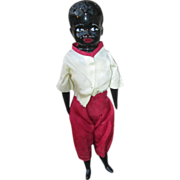 Black vintage china boy doll