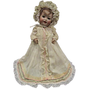 Darling small Antique character baby doll