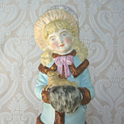 German Bisque Figurine of Victorian Young Lady with Muff and Pug Dog