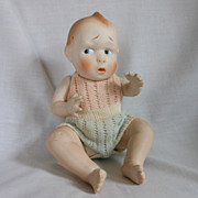 German All Bisque Character Baby with Worried Expression