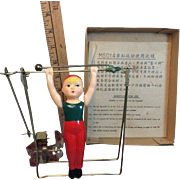 Tin And Celluloid Key Wind Mechanical Circus Trapeze Twirling Boy MIB China