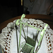 Antique Green Metal Doll Swing with Ornate Details
