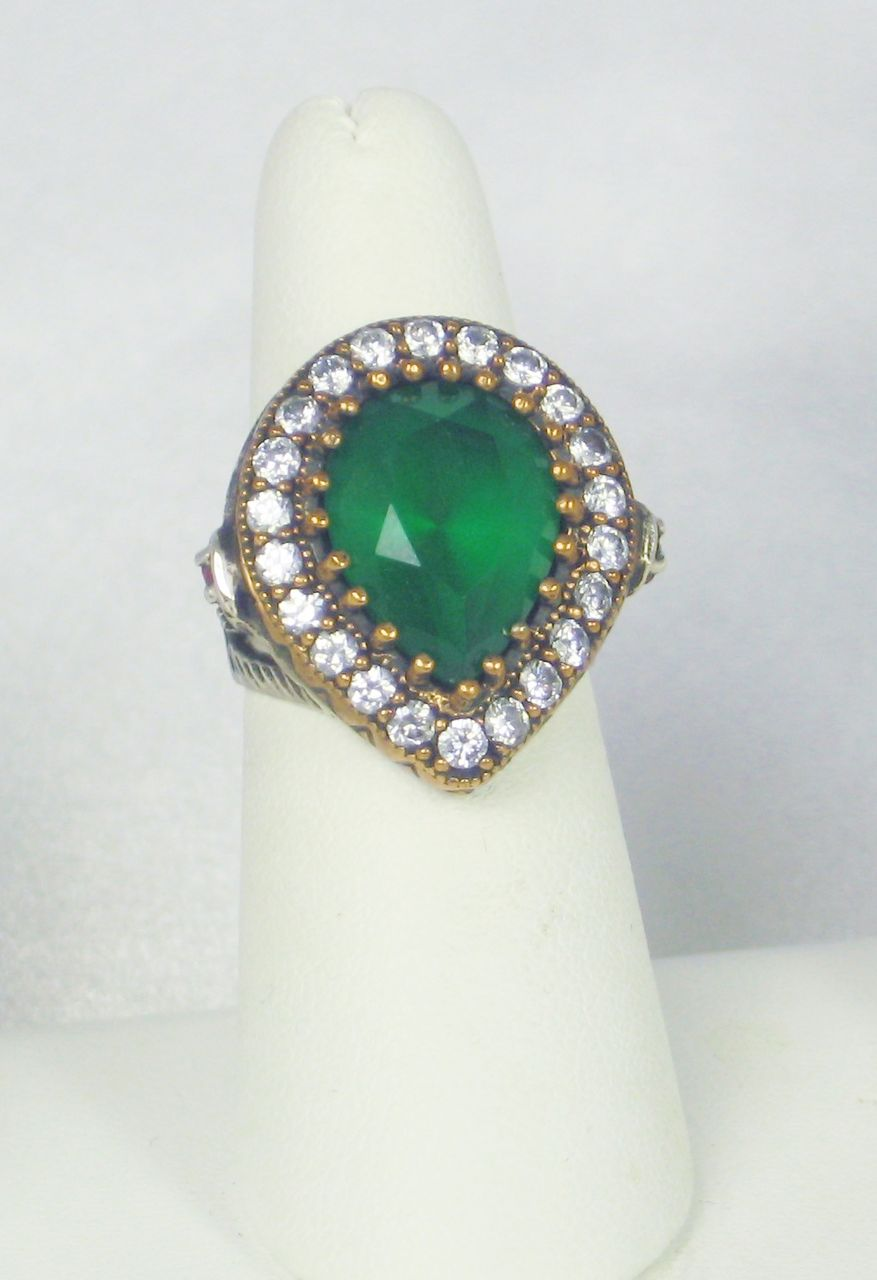 925 sterling and simulated ruby and emerald ring