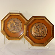 SOLD Pair of octagonal framed gilded and framed classical Roman plaques