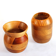 Two hand carved signed treenware vases, hemlock and mixed woods
