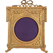 Antique Gilded Cast Iron Bow Top Frame