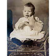 Antique 1895 PHOTOGRAPH Postcard, Baby, Ornate Wicker Stool,  VELVETEEN CAT Toy