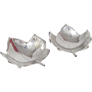 A Pair of Sterling Silver Cartier- Sciarrotta Leaf Dishes