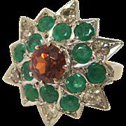 18 K White and Yellow Gold Starburst Ring with Spessartite Garnet, Emeralds, and Diamonds
