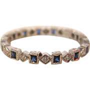 18 K White Gold, Sapphire, and Diamond Eternity Band