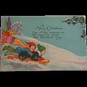 SALE Christmas Postcard Children Sledding 1928