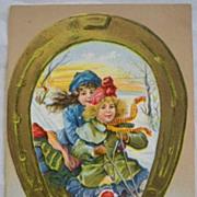 SALE Vintage Christmas Postcard Embossed  Little Girls Sled Horseshoe