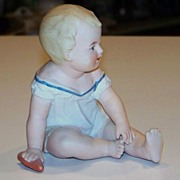 "Germany Reichmannsdorf Porcelain Co. Vintage 1900's ""Sitting Piano Baby"" 4-1/2"" Tall"