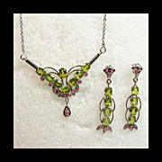 Rhodium Plated Sterling Silver Necklace and Earrings with Peridots and Ruby Accents
