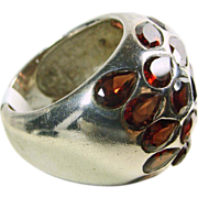 Large Sterling Silver Dome Ring Covered with Bezel Set Red Garnets