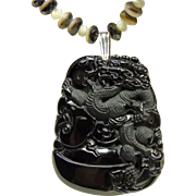 SALE Carved Black Obsidian Dragon Pendant on a Necklace of Black and White MOP Rondelles