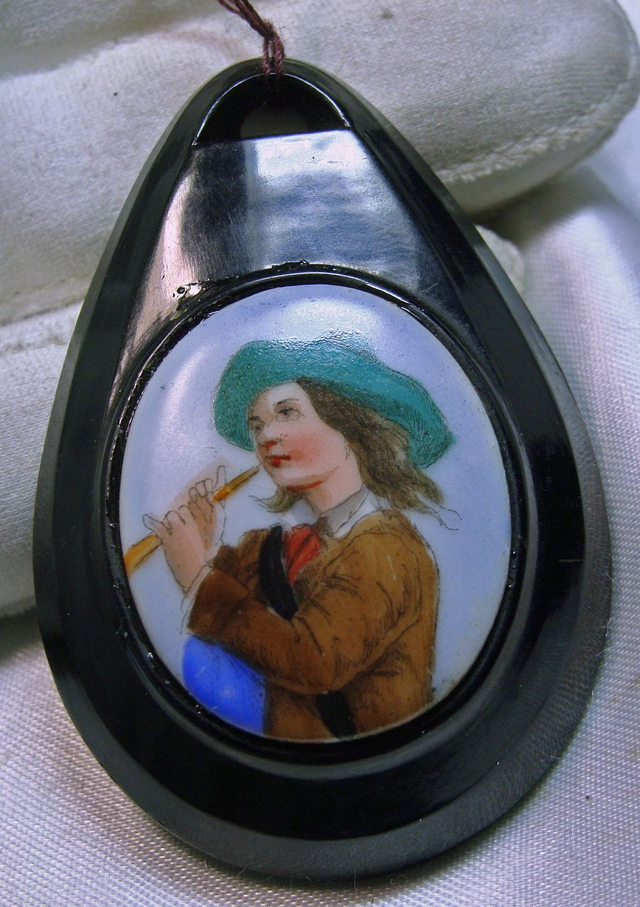 Jet Pendant with  Embedded  Oval Porcelain of a Youth with a Flute
