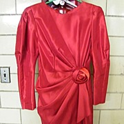 Red Taffeta Sheath With Side Pleated draped Peplin & Self Rose Flower At Waist..By La Cadence Premier Size 9 AR..Imported..Excellent Condition