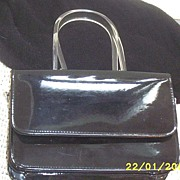 DESIGNER..Jeanne Lottie Handbag..Black Patent Leather With Twisted Lucite Handle