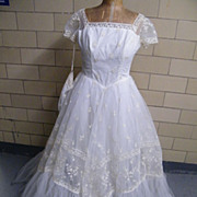 Designer Wedding Gown Of Tulle With Embroidery..Multi-Layered..Square Neck..Short Sleeves..Matching Glovelets