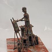 Metal Sculpture of an Artist...