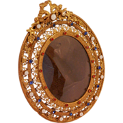 Gilt Filigree jeweled Frame on Brass...