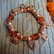 Vintage Stretchy Silvertone Bracelet With Repousse Hearts and Topaz Colored Stones